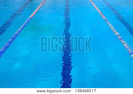View on the swimming-pool with blue water and a lane of the swimming-pool.