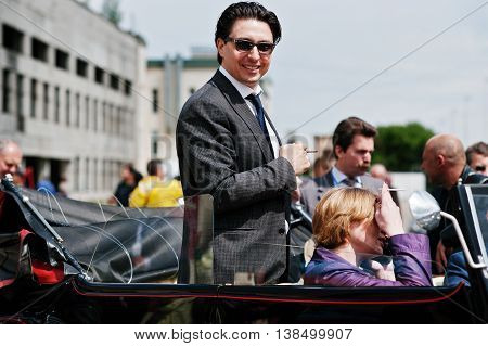 Podol, Ukraine - May 19, 2016: Elegant Man On Sunglasses Ray Ban With Cigarette Stay And Smile On Ma