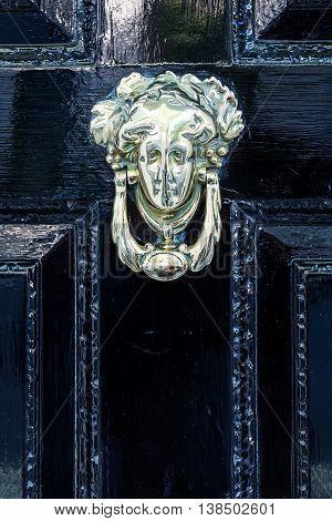 Old Doorknocker At A Door In London, Uk
