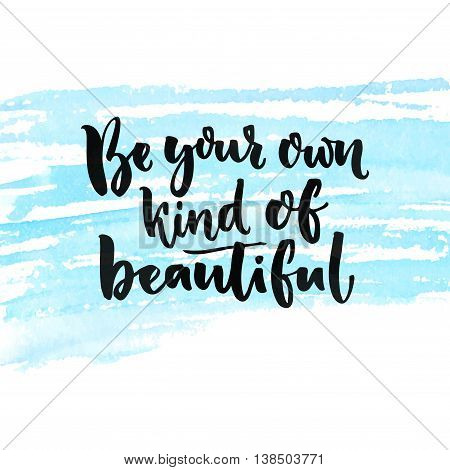 Be your own kind of beautiful. Inspirational quote about beauty and self esteem. Brush lettering at blue watercolor texture