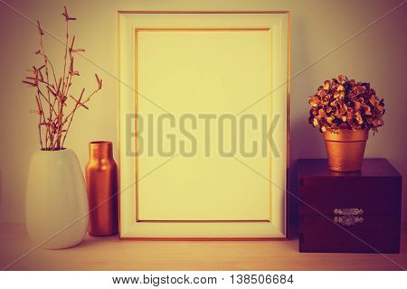 Frame mockup with wooden box vintage styled. Portrait or poster white frame mockup. Empty white frame mockup for presentation artwork.