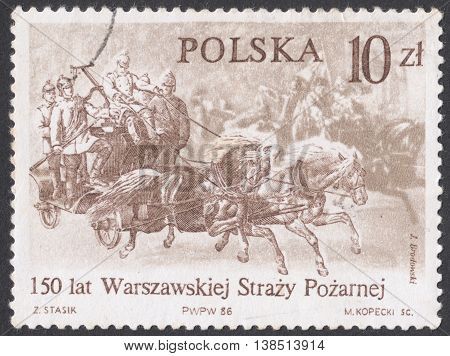 MOSCOW RUSSIA - CIRCA FEBRUARY 2016: a post stamp printed in POLAND shows the Warsaw Fire Brigade in a Krakow suburb on the way to a fire in 1870 the series