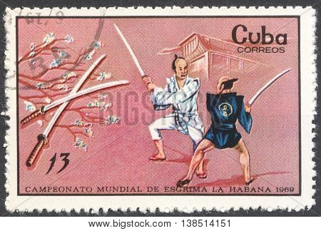 MOSCOW RUSSIA - CIRCA FEBRUARY 2016: a post stamp printed in CUBA shows samurai fencing the series