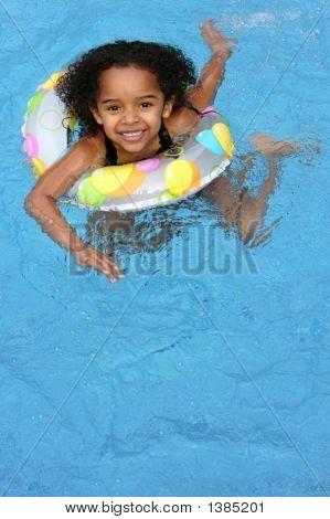 Child Having Fun In A Pool