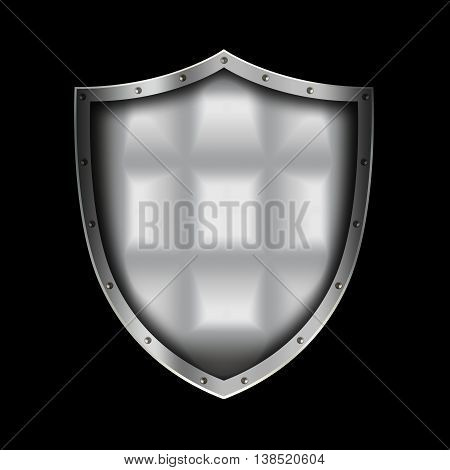 Medieval silver shield with riveted border on black background.