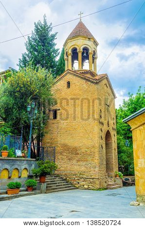 TBILISI GEORGIA - MAY 28 2016: The brick bell tower of the Georgian Orthodox Jvris Mama Church on May 28 in Tbilisi.