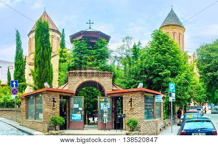 TBILISI GEORGIA - MAY 28 2016: The gate leads to the Georgian Orthodox Jvris Mama Church and Armenian church of Norashen located in Kote Abkhazi street on May 28 in Tbilisi.