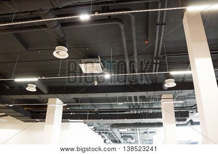 Air Duct, Danger and the cause of pneumonia in office man. Air conditioning system. Lighting Systems. Ventilation and lighting on the ceiling building. conditioner installation system