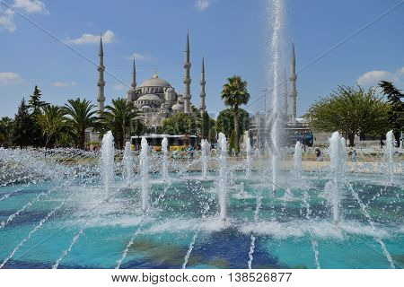 ISTANBUL - AUGUST 7: View of the Blue Mosque (Sultan Ahmed) with fountain, August 7, 2013 in Istanbul, Turkey. Sultan Ahmed Mosque (Blue Mosque) on of most popular tourist attractions in Istanbul.