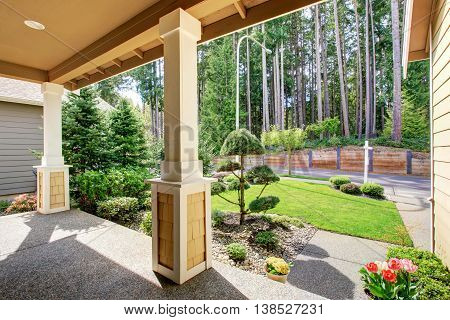 View Of Well Designed Landscape From The Covered Porch.