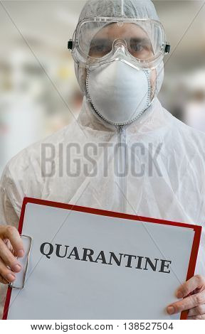 Quarantine concept. Man in coverals is warning.