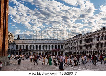 VENEZIA, ITALY - MAY 2015: Napoleonic Wing and Procuratie Vecchie's arcades in Saint Mark's Square in Venice Italy