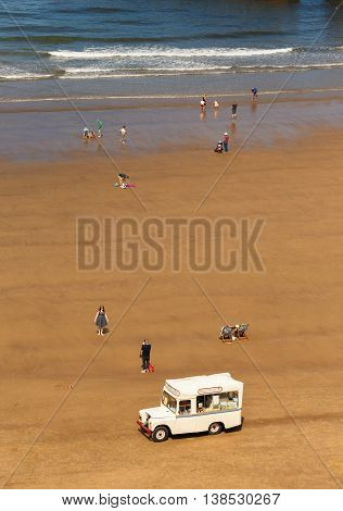 WHITBY ENGLAND - JULY 12: A 'Whitby Ice Cream Co' ice cream van on the beach. In Whitby North Yorkshire England. On 12th July 2016.