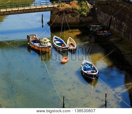 STAITHES ENGLAND - JULY 12: Fishing boats in Staithes Beck. In Staithes North Yorkshire England. On 12th July 2016.