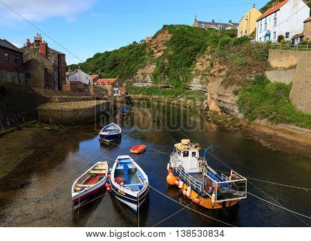 STAITHES ENGLAND - JULY 12: Fishing boats moored up in Staithes beck. In Staithes North Yorkshire England. On 12th July 2016.