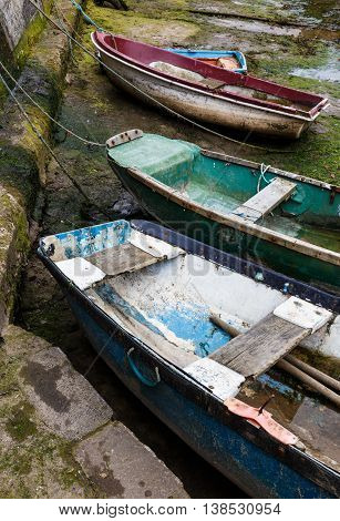 STAITHES ENGLAND - JULY 12: Small wooden fishing boats in Staithes Beck. In Staithes North Yorkshire England. On 12th July 2016.