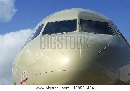 Closeup of a Gold Coloured Airplane Cockpit