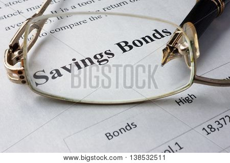 Page of newspaper with words savings bonds. Trading concept.