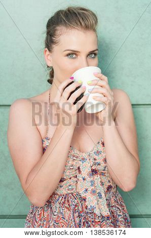 Attractive Lady Sipping From Takeaway Coffee Mug