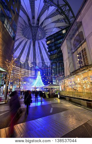 BERLIN - NOVEMBER 23: tourists in Sony Center on Potsdamer Platz in Berlin, Germany on November 23, 2013. Sony Center is a Sony-sponsored building complex located at the Potsdamer Platz.
