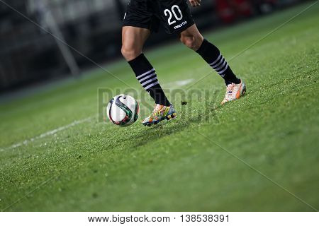 Ball And A Feet Of A Soccer Player