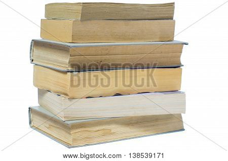 Vertical stack of old books isolated on white background. Stack of books in hard and soft cover.
