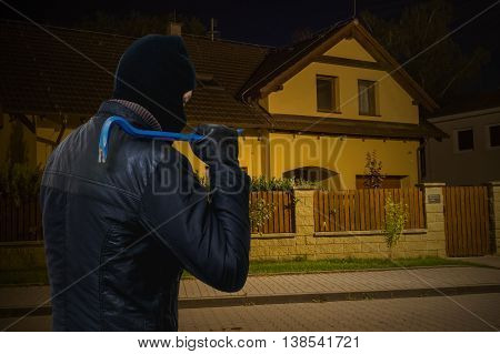 Masked Bandit Or Criminal Is Going To Rob House At Night.