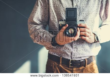 Old Medium Format Camera In Photographer Hands