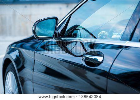 Closeup Shot Of Black Modern Car's Side Mirror
