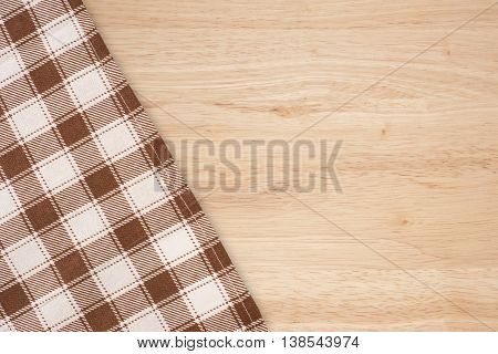 Checkered Tablecloth On The Wooden Background. Checkered Tablecloth On The Wooden Background.