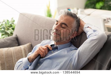 Businessman Relaxing On The Couch