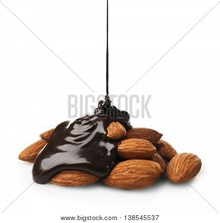 Melted chocolate with almond nuts, isolated on white