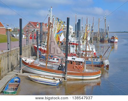 Low Tide in Crab Fishing Harbor of Ditzum in East Frisia at german North Sea,Lower Saxony,Germany