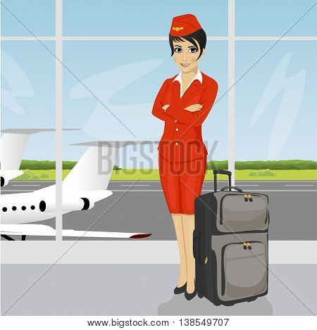 beautiful asian air hostess posing with luggage in front of an airport observation deck