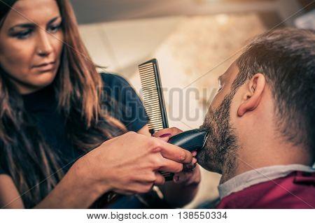 Barber Beard Cut A Client's Beard With Trimmer