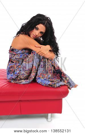 Sexy brunette in summer dress posing on footstool
