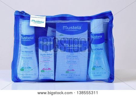 KIEV UKRAINE - November 28 2011. Illustrative editorial photo - Baby cosmetics isolated on white. A set of infant natural cosmetics to bring along on the road - Mustela