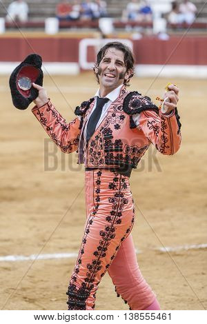 Andujar Spain - September 23 2011: The Spanish Bullfighter Juan Jose Padilla greeting the public with its cap in the hand in gratitude to its bullfight in the Bullring of Andujar Spain