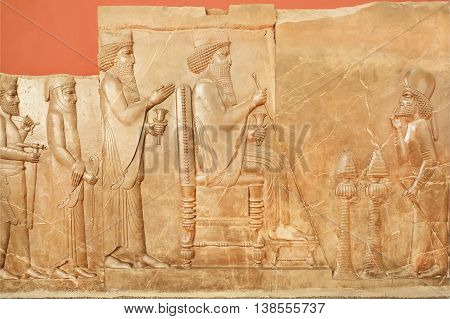 Carved wall of Persepolis showing king Darius life on relief in National Museum of Iran. Established in 1937 in Tehran museum contain artifacts from Achaemenid period.