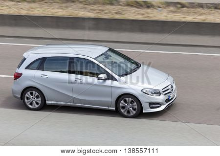 FRANKFURT GERMANY - JULY 12 2016: Mercedes Benz B Class compact luxury van on the highway in Germany