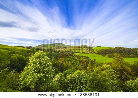 Landscape Scenery Of Green Valley, Hill And Cloudy Blue Sky