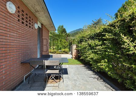 Patio of a modern brick house, outdoors
