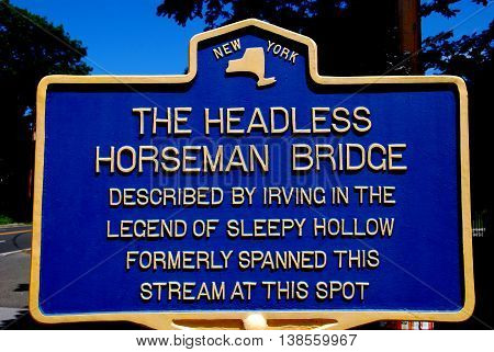 Sleepy Hollow NY - July 9 2009: State historic marker at the Headless Horseman Bridge notes the site in Washington Irving's story