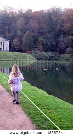 Girl Walking Beside The Lake In The Evening.Autumn/Fall