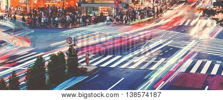 Motion Blurred Traffic At Shibuya Crossing In Tokyo, Japan