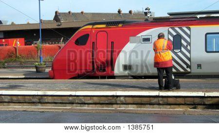 Man In Railway/Train Station Standing Beside Train