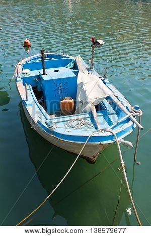 Boat anchored at the seaport of Giovinazzo. Puglia. Italy.