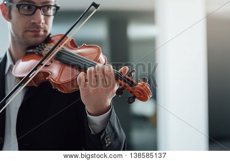 Talented violinist and classical music player solo performance blank copy space on right poster