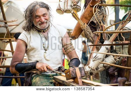 Monterenzio Italy 09 July 2016 -  wood carver blacksmith craftsman realize weapons during a Celtic Festival