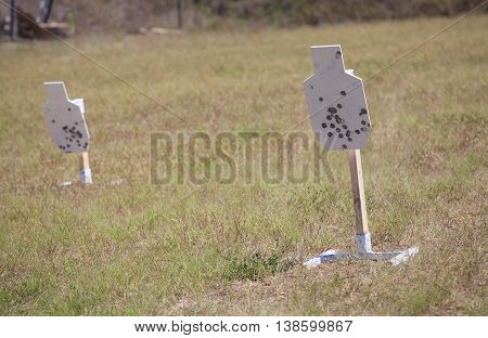 Pair of white steel targets ready for firearm practice